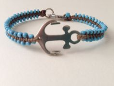 Silver 925 maritime Anchor integrated into beaded bracelet made out of waxed thread