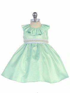 Immerse in the heart of elegance and good taste with this beautiful creation from Crayon Kids. Stylish fit and flare dress features a glossy shine and a bejeweled neckline. Plain sage color for a distinctive note. Stunning dress will make your baby girl f Green Flower Girl Dresses, Girls Dresses, Summer Dresses, Easter Dress, Little Girl Fashion, Stunning Dresses, Baby Bodysuit, Baby Dress, Fit And Flare
