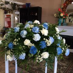 Shades of blue & white carnations casket spray by Donna Jeffries