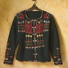 Beginning in the 18th century, the art of rosemaling, or flower painting, spread in rural Norway as artist traveled from village to village, decorating churches and homes. The hand-stitched patterns that adorn this square neck, perfect-for-layering, oatmeal-colored jacket are inspired by elements of this decorative folk art. The traditional pewter clasps enhance the Scandinavian artistry of the naturally wind-resistant and quick-drying boiled wool. Imported.
