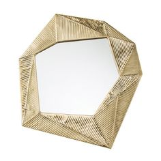 If origami is an art form then this irregular shaped mirror is an example of how one art form can influence and inspire another. The solid brass frame takes on