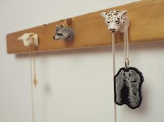 Decapitated toys as coat rack - genius! Animal Figurine Jewelry Rack — DIY How-to from Make: Projects Lego Key Holders, Jewelry Rack, Jewelry Holder, Necklace Holder, Skull Necklace, Diy Jewelry, Plastic Animals, Animal Heads, Old Toys