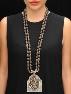 Buy Silver Brown Lord Ganesh Wooden Beads Necklace 92.5% Sterling Jewelry Sparkling Notes Handcrafted Earrings and Necklaces Online at Jaypore.com
