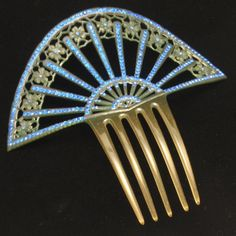 Celluloid comb with rhinestones.