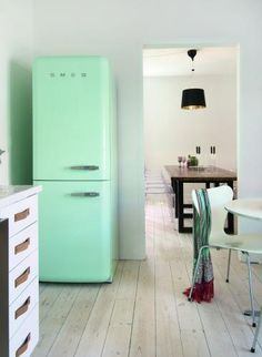 love the calm, subdued kitchen.  Not sure I could restrain my self with color, but look at that soft minty fridge.....