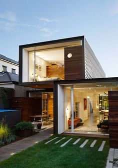 A trio of glass-ended boxes forms this compact Melbourne house by Austin Maynard Architects
