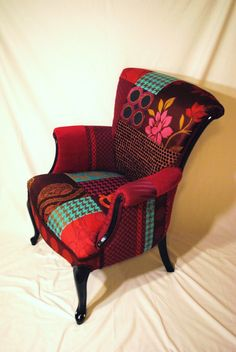 This chair is made up mostly from a beautiful collection of Osbourne and Little fabrics consisting of an array of colours - mostly plums, fuchsias,