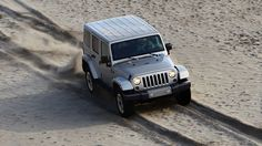 2013 Jeep® Wrangler Unlimited Sahara shown in Billet Silver with matching hardtop.