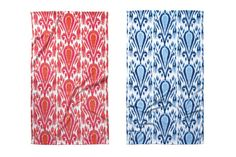 Ikat-inspired beach towels by John Robshaw Textiles are shown in red and blue; $40 each. johnrobshaw.com
