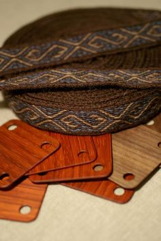 Tabletwoven wool braid with s-motif. Love the natural colors and wooden cards.