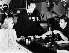 Ginger Rogers and Fred Astaire pay attention to Swing Time director George Stevens 1936