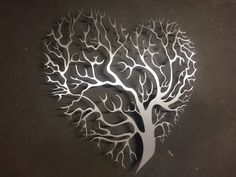 Heart Shaped Tree Metal Wall Art - Abstract Wall Decor - Tree of Life Perfect for the home & will fit right in with stainless steel appliances! Trees symbolize many things, including wisdom, protection, strength, bounty, beauty, and redemption. This 24 x 24 Heart Shaped Tree Metal Art piece is made from a thick yet lightweight sheet of aluminum, laser cut, brushed by hand and uniquiely painted with the colors of your choice. Inspire Metals Art is only made using high-strength American ...
