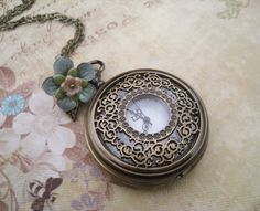 Vintage Style Filigree Pocket Watch with Flower Necklace. $35.00, via Etsy.