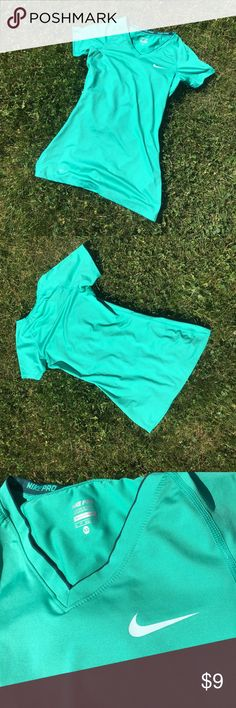 Nike Pro Shirt Selling this Nike Pro dri-fit shirt in a gorgeous green color. Fitted, size xs. See fourth picture for small faint discoloration-- not at all noticeable even if you know it's there! Nike Tops Tees - Short Sleeve