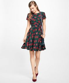 """<a href=""""#pdplearnmore"""" class=""""lm"""">The Red Fleece Collection</a><br>Fully lined, this short-sleeve rose dress is made of silk crepe de chine and has a fitted bodice and a full skirt for a flattering silhouette.<br><br>Center back zipper; 36""""; dry-clean only; imported."""