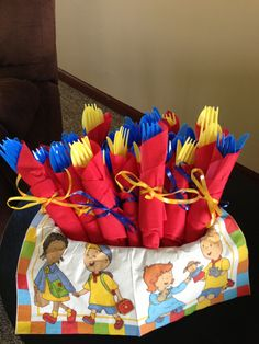 Silverware in primary colors. Caillou birthday party.