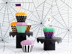 Sweeten your Halloween with these easy-to-assemble cupcake treat boxes. I have made SIX (6) cute patterns inspired by Halloween candies and treats. There are several patterned flags included with editable text for you to personalize, a spider, a ghost, a witch hat, and a B and an O to spell Boo that can be added to the tops. Nothing will be emailed or shipped to you! The PDF can be downloaded directly from Etsy once payment has cleared. Detailed downloading instructions can be seen below…