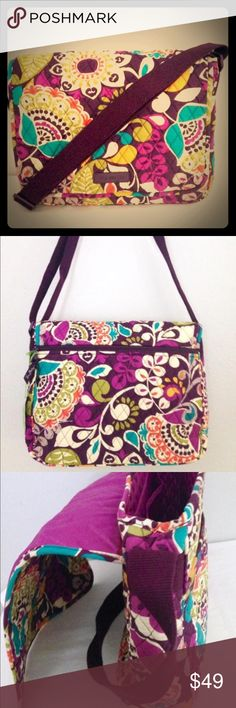 NWT PLUM CRAZY messenger tote Vera Bradley This is one good move! Made of 100% man-made materials. Buckle closure. Adjustable, cross-body strap. Exterior zip pocket with two slip pockets. Five interior slip pockets. Imported. Measurements: Bottom Width: 14 3⁄4 in Middle Width: 14 3⁄4 in Top Width: 14 3⁄4 in Depth: 4 in Height: 11 in Strap Length: 54 in Strap Drop: 25 in Weight: 1 lb 4 oz This product may have a manufacturer's warranty. Vera Bradley Bags Laptop Bags