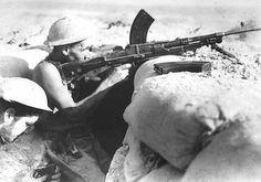 Australian troops in a foxhole with Bren gun near Tobruk in Libya, August 1941.