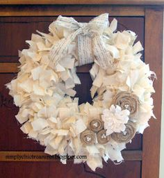 muslin rag wreath - so easy! By Simply Chic Treasures - I made one similar but I used extra long trash bags - cut into strips and tied onto a coat hanger.  Added embellishments for the holidays and it looks great from both sides (had no $ to spend on Christmas decorations for school.  Kids/teachers love it.