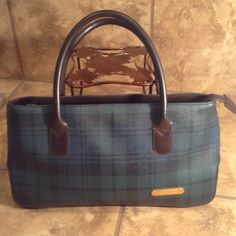 """Ralph Lauren Vintage Tartan Plaid Handbag Vintage 1990's Ralph Lauren bag. Rare find with current, classic style. Measures 12"""" width, 7"""" height and 3"""" base width. Primary green and black plaid with brown leather trim and gold studs. Excellent condition including handles. Bags Satchels"""