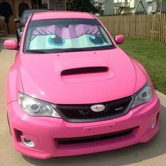 Subaru WRX! Check out that sunshade that matches a gorgeous pink!