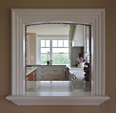 molding on kitchen to living room pass through | home decor/diy