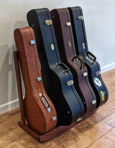 Solid, hard wood rack for all of your guitar and/or banjo cases. Your instruments are valuable, and important to you. They are safest when in their case, and should always be stored vertically. Our guitar/banjo case racks are made of solid Walnut and will last for generations. There is NO external Guitar Stand, Guitar Case, Mdf Wood, Wood Veneer, Danish Oil Finish, Display Easel, Pvc Fabric, Wood Rack, American Craftsman