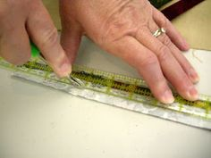 """How to iron a straight line... Very cool tip.  """"What you do is run the wheel along the edge of the ruler where you want your fold to be. This """"scores"""" the fabric, not cutting any fibers, but making a nice dent. Marie says she can get as small as a 1/8"""" fold this way (good for those fine flower stems in applique.)"""" Allie"""