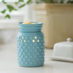 This sky blue glaze and hobnail pattern lets this versatile warmer go with either modern or traditional decor.