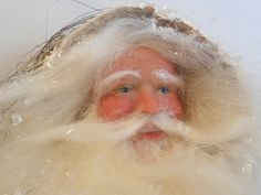 Santa by Lois Clarkson - with a warm and gentle face. Her Santas are inspired by antique postcards.