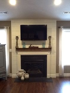 Finally finishing the living room. New floors and shiplap fireplace surround.