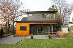 great modern rear addition on a little cape cod.