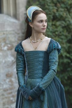 "Anne Boleyn (Natalie Portman) in ""The Other Boleyn Girl"".  Costumers for the film clothed the actress in cool colors to underscore Anne's more studied habits and actions, a direct contrast to the warm colors and open personality of her sister Mary."