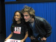 Pic of Rob from Austin Film Festival. I love the whole interaction with Rob and this little girl, so very sweet.