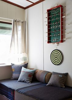Upcycled foosball and dartboard turned into wall decor.
