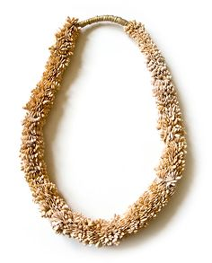 Karin Roy Andersson  Necklace: A Constant Grinding 2012  Galia melon seeds, textile, brass
