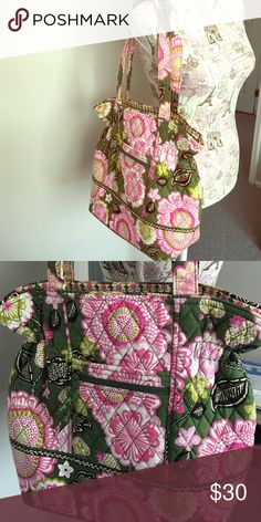 "Vera Bradley bag This is a new Vera Bradley bag.  No tags but never used.  Perfect condition  button closure. Has zipper and pockets in the inside. Measures 15"" wide from the middle and 13"" tall not including straps. Also has pocket and zipper on outside. Vera Bradley Bags"