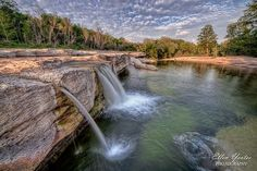 """McKinney Falls State Park -One of the hidden treasures around the austin area --> right off inside the city limits you have this park standing 100's of acres to nurture wildlife and flora/fauna. The Waterfalls is amazing usually visit after the """"Texas shower time - May showers"""" where the whole park transforms into a lush green belt embracing every heart and mind within her. Very well maintained trails, camping spots and friendly park staff to clearly instruct the visitor needs"""