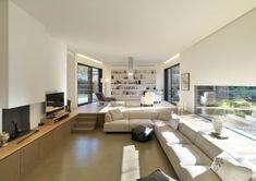 Interesting, I like the windows and bookcase...  Sassuolo House by Enrico Lascone Architects