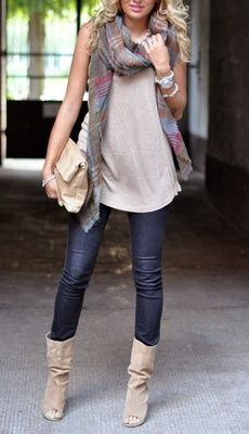 Baggy top, scarf, jeans & boots.