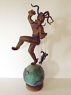 A personal favorite from my Etsy shop https://www.etsy.com/listing/569424104/jester-spinning-sculpture