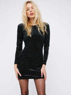 Gabby Velvet Mini Dress | Velvet bodycon mini dress featuring allover metal studs. Three-quarter length sleeves and a low scoop back.