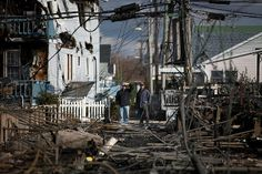 Residents look over the damage in the Breezy Point neighborhood of Queens, N.Y., on Oct. 31