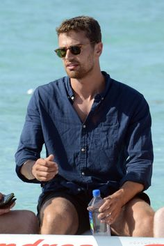 Question: Why Is Theo James Wearing a Shirt in These Photos?