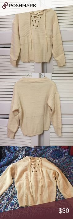Lace Up Sweater cream colored lace up sweater. never worn. great condition. Sweaters