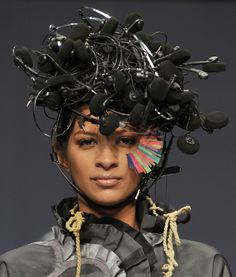 """Collection: Conditions Apply II  Materials: Head phones and Wires.  Story: This headgear takes inspiration from the story """"urbanization"""". The chaotic placement of the head phones depicts the chaotic existence of our generation. Although we all exist as individual yet are lives are messed up in its own way.  #recycle #nitinbalchauhan #fashion #headgears"""