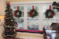 I made these 3 wreaths for my kitchen window this year. Pinterest inspired of course. I purchased real wreaths- $5 ea at Home Depot at 5:30 AM on Black Friday. I bought wooden letters at HOBBY LOBBY and painted them red and wired them on.  Perfect for a triple window.