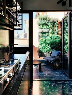 dark colors, dark woods, lots of chrome and leather are the luxe materials found in this tiny home. All the finishes—the dark marble backsplash, the wood-paneled walls, the brass that frames the kitchen doorway—are so luxurious that I wish I could reach out and touch them through my computer screen. The louche, '70s vibe is so different from the careful, minimalist interiors that are current in interior design right now, and yet still somehow so cool.