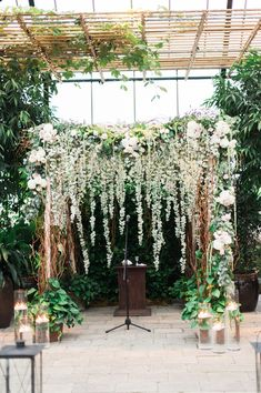 floral ceremony arch - photo by Kelly Sweet Photography http://ruffledblog.com/best-of-2015-wedding-ceremonies